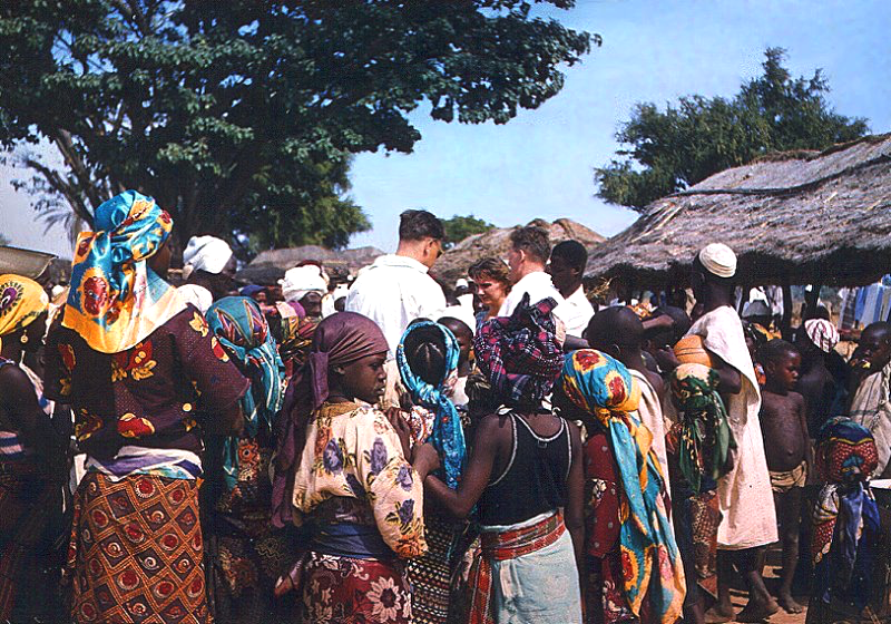 Market events in Zaranda, Nigeria 1958: local population and colonial officials in exchange