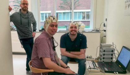 Demonstration of one of the EEG paradigms used at the Center for Music in the Brain. Jan Stupacher in the back with two colleagues.
