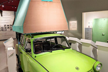 Trabi with camping tent on the roof exhibited in the DDR Museum Berlin.